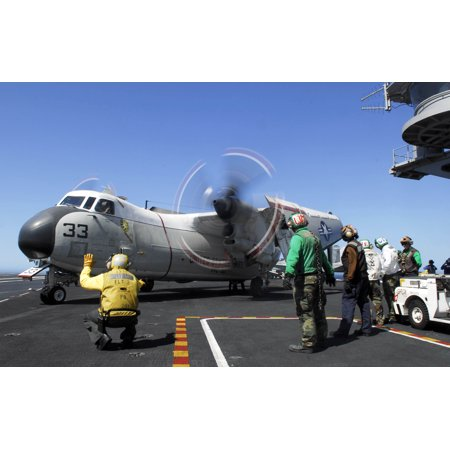 LAMINATED POSTER Sailors act as prop safeties as a C-2A Greyhound from the Providers of Fleet Logistics Support S Poster Print 24 x 36 - Sailor Props