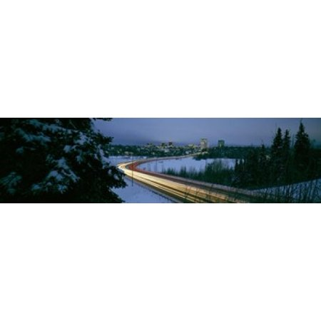 Autumobile lights on busy street distant city lights frozen Westchester Lagoon Anchorage Alaska USA Canvas Art - Panoramic Images (21 x 6) - Party City Westchester