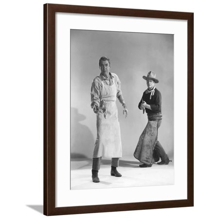 THE MAN WHO SHOT LIBERTY VALANCE, 1962 directed by JOHN FORD James Stewart and John Wayne (b/w phot Framed Print Wall Art