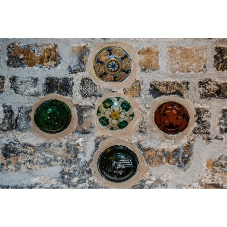 Canvas Print Decorative Stone Plates Built In A Wall Wall Stretched ...