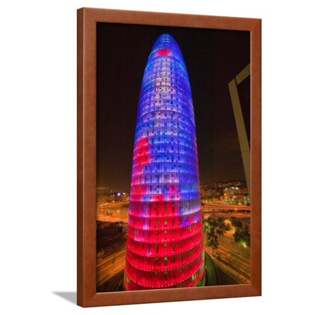 Night view of phallic-shaped Torre Agbar or Abbar Tower in Barcelona, Spain, designed by Jean No... Framed Print Wall Art