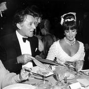 Elizabeth Taylor and Richard Burton at dinner Photo Print by Globe Photos LLC