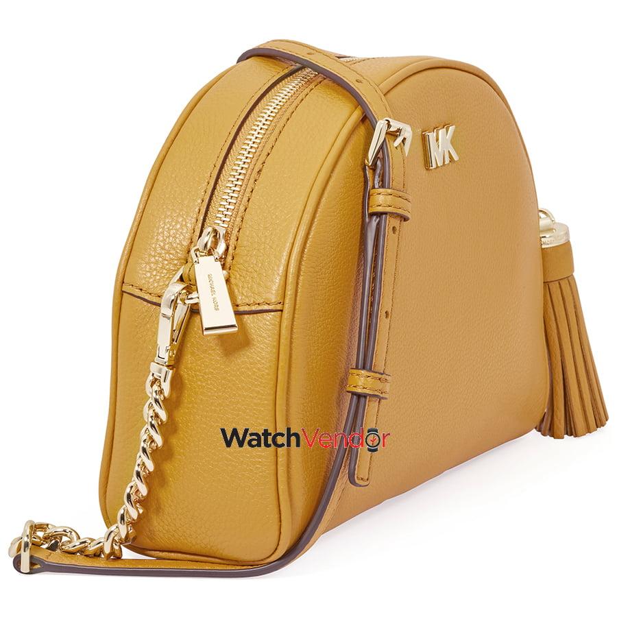 b0e36140620e Michael Kors Ginny Pebbled Leather Half-Moon Crossbody Bag- Marigold