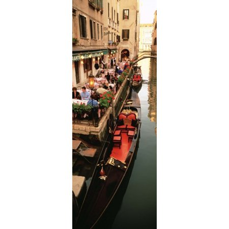 Gondolas moored outside of a cafe Venice Italy Stretched Canvas - Panoramic Images (18 x