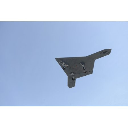 Atlantic Ocean May 17 2013   An X 47B Unmanned Combat Air System Demonstrator Flies Over The Flight Deck Of The Aircraft Carrier Uss George Hw Bush Poster Print