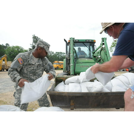 LAMINATED POSTER Members of the Arkansas National Guard's 77th Theater  Aviation Brigade help fill and place sandbags Poster Print 24 x 36