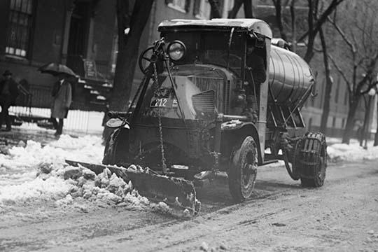 Tank Truck with Snow Plow Cleans the Streets Poster Print by Buy EnLarge