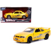 """Leon's Nissan Skyline GT-R (BCNR33) Yellow Metallic with Graphics """"Fast & Furious"""" Series 1/32 Diecast Model Car by Jada"""