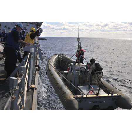Uss Alligator - Atlantic Ocean January 31 2012 - Sailors haul a rigid-hull inflatable boat from the water aboard the Arleigh Burke-class guided-missile destroyer USS Porter during exercise Bold Alligator 2012 Poster