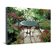 Metal Table and Chairs on Patio Backed by Pots with Lilium Longifolium Stretched Canvas Print Wall Art By Lynne Brotchie