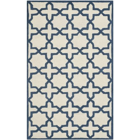 Safavieh Cambridge 4' X 6' Hand Tufted Wool Rug in Ivory and Navy - image 1 de 1
