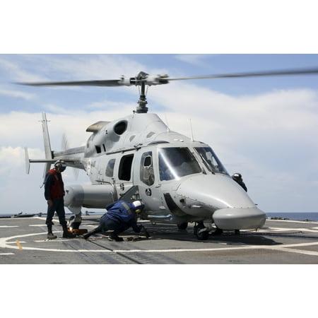 US Sailors chock and chain an Ecuadorian Navy Bell 230 helicopter Canvas Art - Stocktrek Images (35 x