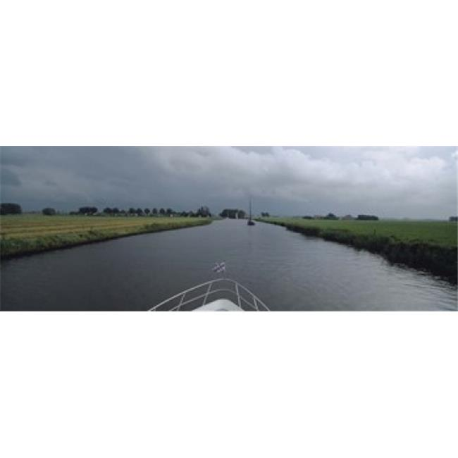 Panoramic Images PPI74027L Motorboat in a canal  Friesland  Netherlands Poster Print by Panoramic Images - 36 x 12 - image 1 of 1