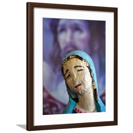 Folk Statue of Our Lady of Guadalupe with Image of Jesus Christ in Background Framed Print Wall Art By Ray