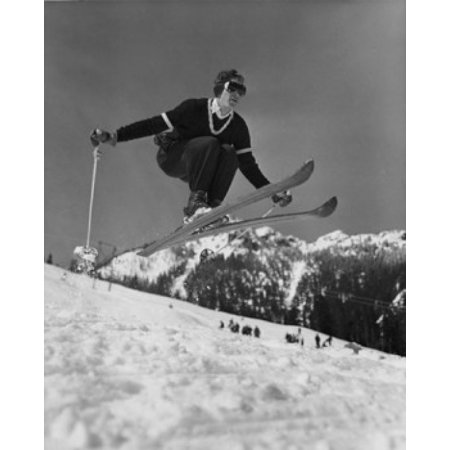 Low angle view of young man skiing downhill Canvas Art - (24 x 36)