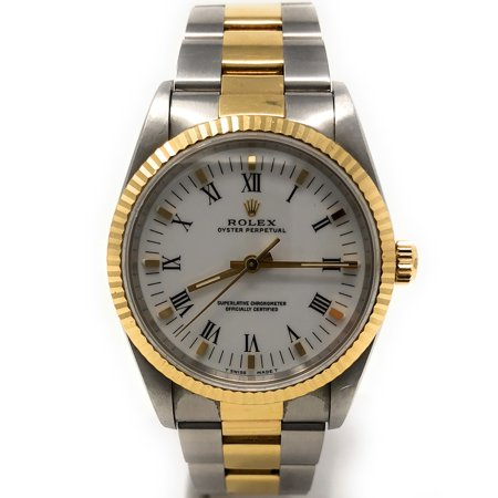 Oyster Perpetual 14233 White Roman dial and an 18kt Yellow Gold Fluted Bezel (Certified Pre-Owned)