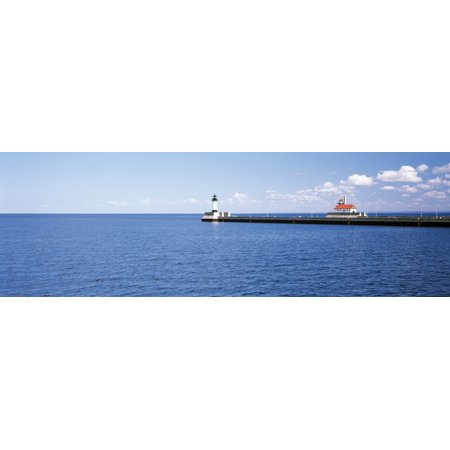 Lighthouse on a pier in a lake Lake Superior Duluth Minnesota USA Stretched Canvas - Panoramic Images (6 x 18)