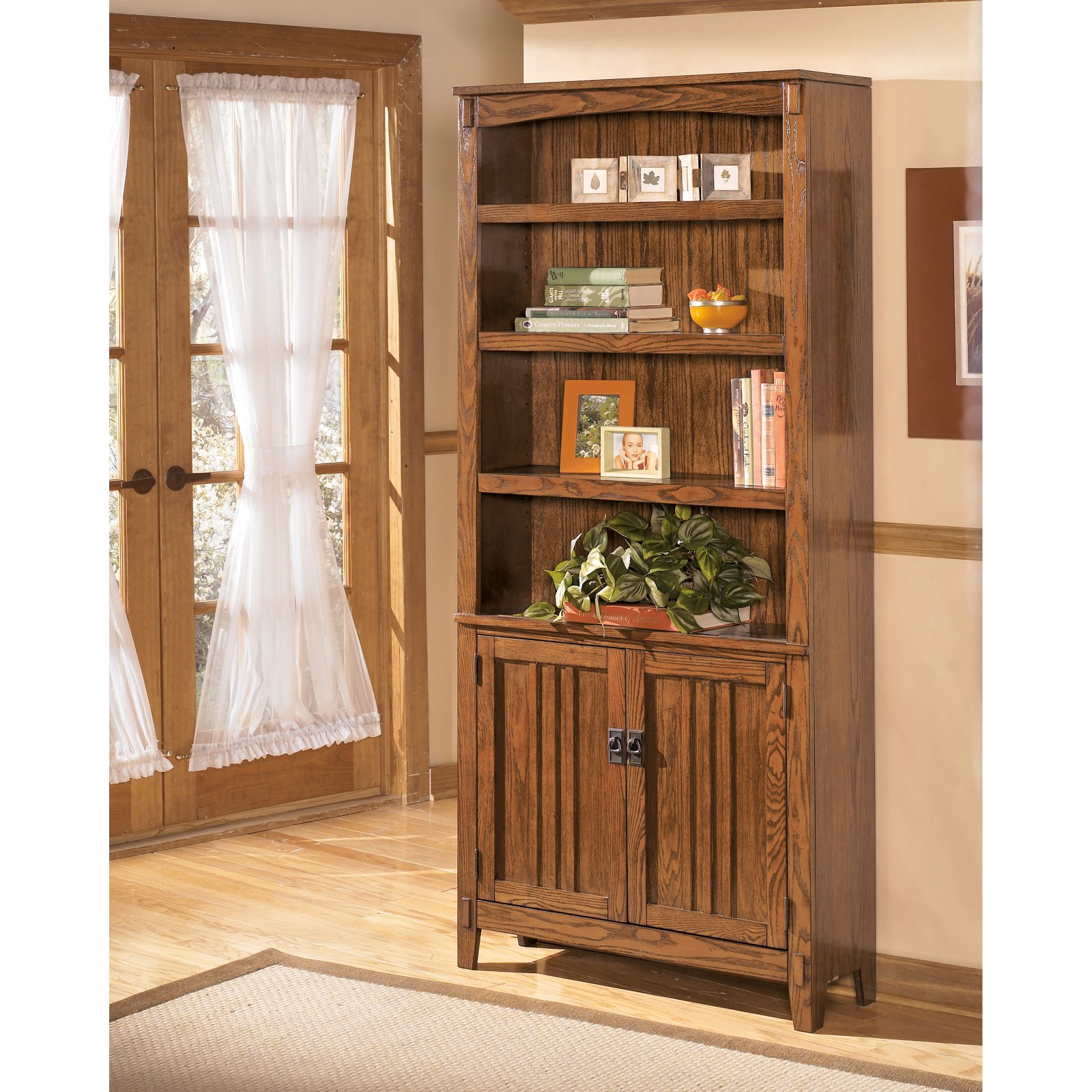 Signature Design by Ashley Cross Island 75 in. Bookcase with Doors