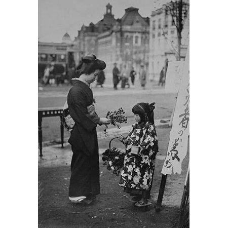 Toddler in front of Kanban Shop sign sells flowers to a kimono wearing young lady who picks them from a basket that the little girls is holding Poster Print by unknown (Does Target Sell Flowers)
