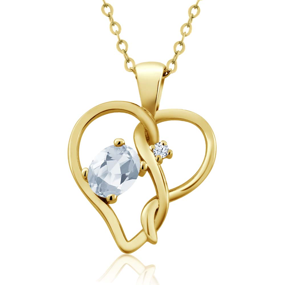 0.56 Ct Oval Sky Blue Topaz White Topaz 14K Yellow Gold Pendant by
