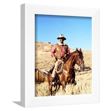 John Wayne on horse in mountains Framed Print Wall Art By Movie Star News