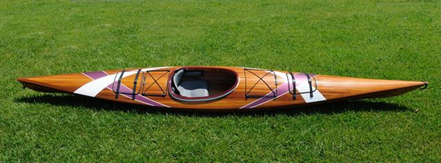 Old Modern Handicraft Kayak with Stripes by