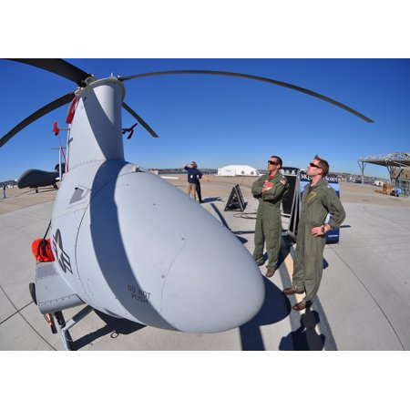 LAMINATED POSTER Navy pilots look at a Fire Scout unmanned aerial vehicle during a static display of current and hist Poster Print 24 x