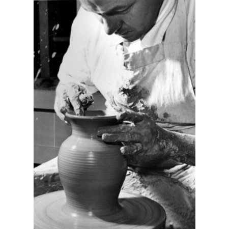 Potter working on a pottery wheel Canvas Art - (18 x 24)