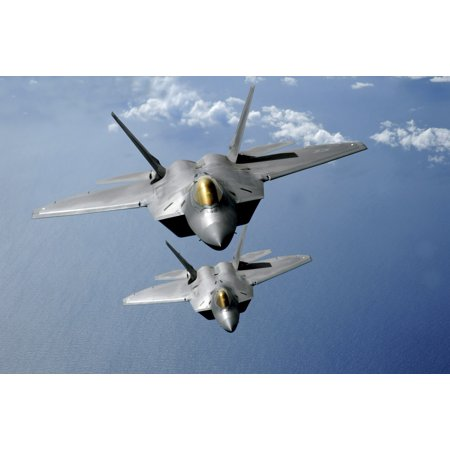 March 9 2009 - Two F-22 Raptors fly over the Pacific Ocean during a theater security mission as part of a deployment to Andersen Air Force Base Guam Poster Print - Ship To Guam