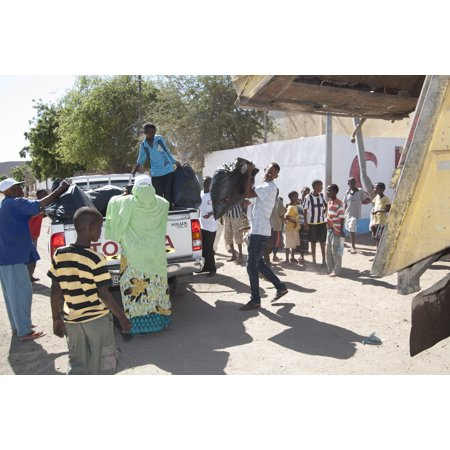 Laminated Poster Citizens Of Ali Sabieh Prepare To Haul Away Bags Of Trash They Collected During A Community Cleanup Poster Print 24 X 36