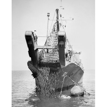 World War Ii Torpedo Net Nus Navy Mine Layer Ship Picking Up An Anti Torpedo Net At Norfolk Virginia Photographed 1945 Rolled Canvas Art     24 X 36