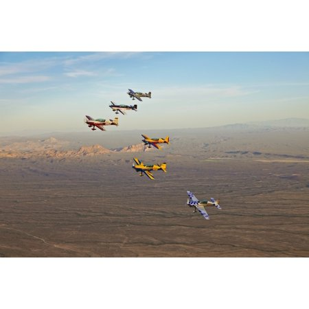 Extra 300 aerobatic aircraft fly in formation over Mesa Arizona Stretched Canvas - Scott GermainStocktrek Images (18 x