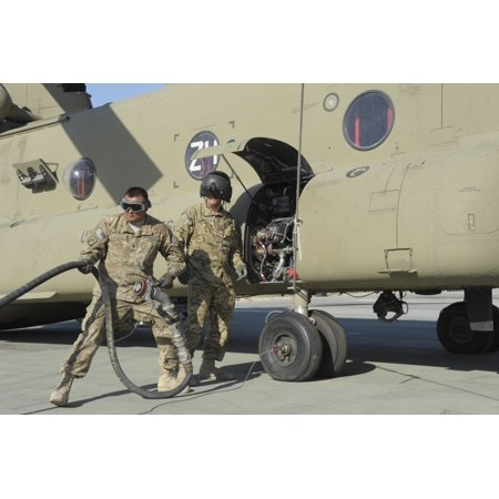 - A fuel specialist pulls the slack on his full line as he and fellow member prepare to refuel a CH-47 Chinook helicopter at Forward Operating Base Kunduz Afghanistan Poster Print