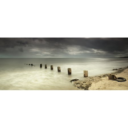 Wooden posts submerged in the water off a beachBerwick northumberland england Canvas Art - John Short  Design Pics (33 x 13) (Halloween Pics To Post)