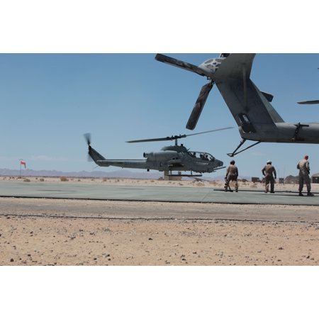 LAMINATED POSTER MARINE CORPS AIR GROUND COMBAT CENTER TWENTYNINE PALMS, Calif.An AH-1W Super Cobra helicopter lan Poster Print 24 x 36