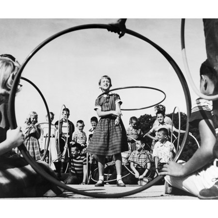 Hula Hoop 1950S Na 10 Year Old Girl Shows Off Her Hula Hoop Skills To Her Classmates 1950S Poster Print By Granger Collection
