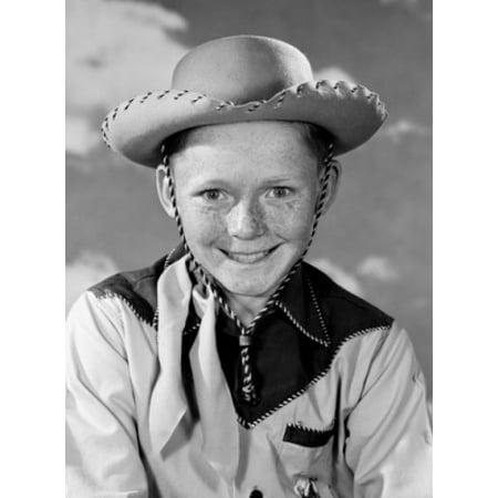 Portrait of boy wearing cowboy costume Canvas Art - (24 x 36)