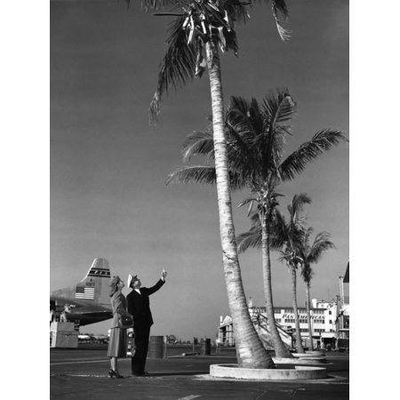 Pilot And Flight Attendant Costume (A Pan American Pilot and Flight Attendant the Edge of the Tarmac at Miami International Airport Print Wall)