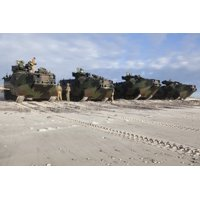 January 10 2014 - US Marines inspect AAV-P7A1 amphibious assault vehicles before a training exercise at Onslow Beach Camp Lejeune North Carolina Poster Print