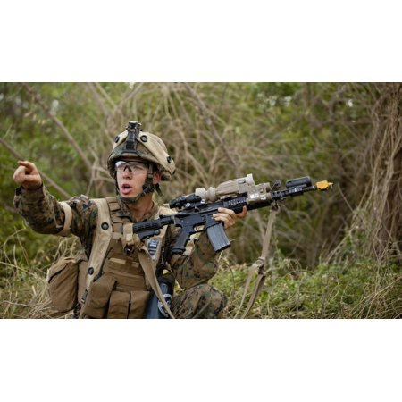 December 7 2012 - US Marine Corps machine gunner directs his fire team after helicopter insertion during exercise Island Viper at Marine Corps Training Area Bellows Oahu Hawaii Poster Print - Marine Corps Gunnery