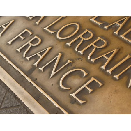 Close-up of a Bronze Sign with Engraved Shiny Lettering Print Wall - Engraved Lettering