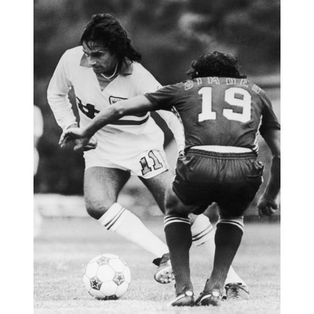Best & Simoes C1977 Ngeorge Best Of The LA Aztecs Competes For The Ball Against Antnio Simes Of The San Jose Earthquakes C1977 Poster Print by Granger