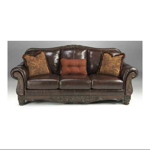 "Signature Design by Ashley  North Shore Plus 94.5"" Stationary Sofa with Plush Rolled Arms  Detailed Carvings and"