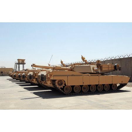 Canvas Print M1A1 Abrams tanks sit parked at a secured compound at the Besmaya Combat Training Center, Iraq. The Stretched Canvas 10 x 14