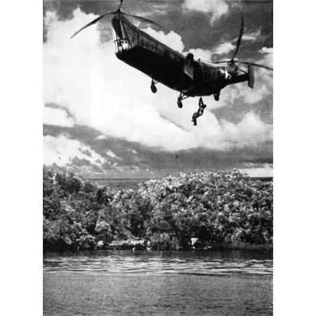 LAMINATED POSTER A U.S. Navy Piasecki HRP-1 picking up a pilot in 1949. The caption explains this as the rescue of a Poster Print 24 x - Caption This