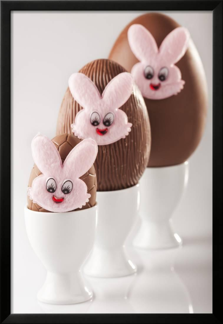 Chocolate Eggs with Bunny Faces in Egg Cups Framed Photographic Print Wall Artwork By Martin Harvey by AllPosters
