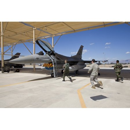 An alert crew from the 162nd Fighter Wing scrambles to an F-16 to prepare it to take off on a training mission from Davis-Monthan Air Force Base in Tucson Arizona Poster Print