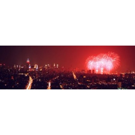 Fireworks display at night over a city New York City New York State USA Poster Print