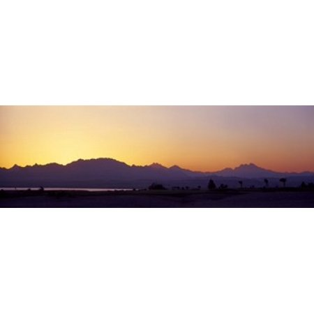 Silhouette of a golf course with Sinai Mountains in the background The Cascades Golf & Country Club Soma Bay Hurghada Egypt Stretched Canvas - Panoramic Images (18 x -