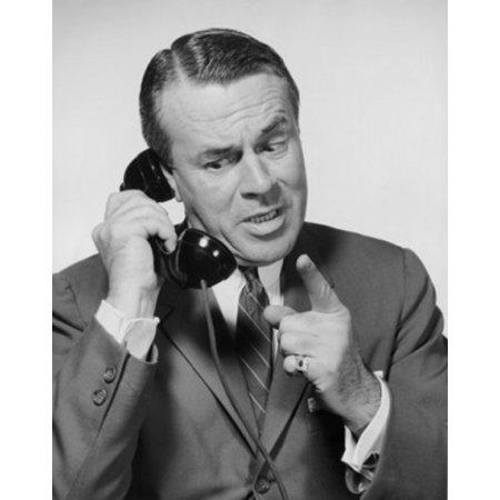 Mid adult businessman talking on telephone Poster Print - Cheap Adult Phone